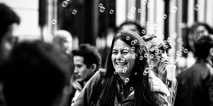 happy woman street bubbles