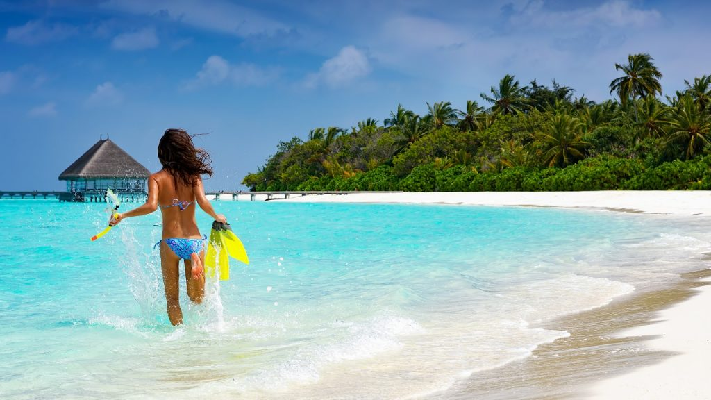 Malediven toeriste snorkelen eiland