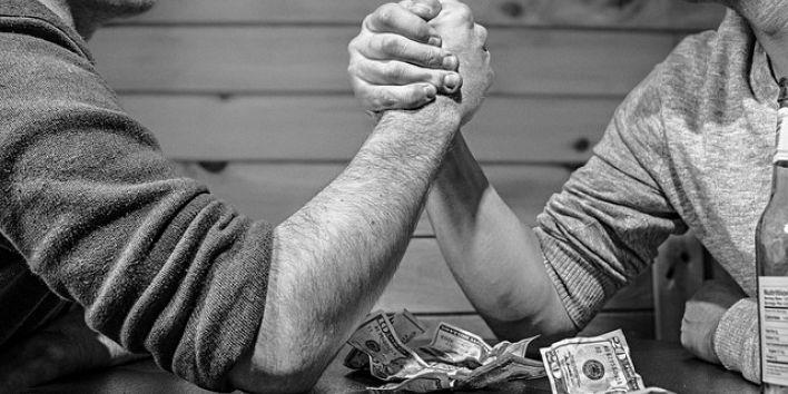 arm-wrestling men power gambling