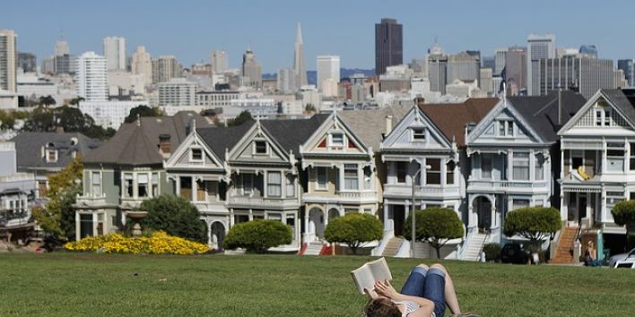 San Francisco woman grass reading book