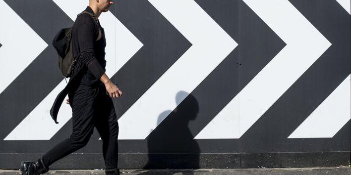 man in black bald hurry hairloss street walk