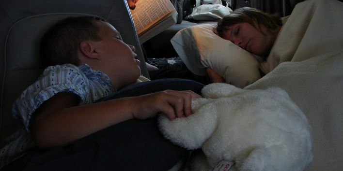 child sleep plane night travel