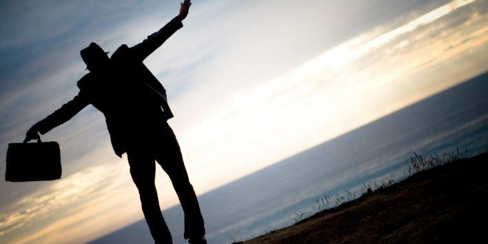 man suit jump happy business success
