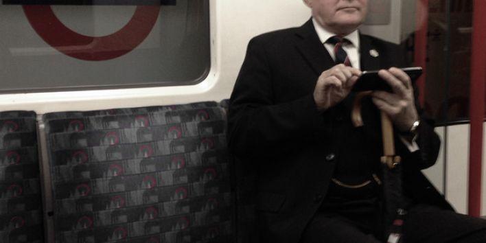 London business man hat tube subway texting