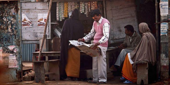 india man street paper read