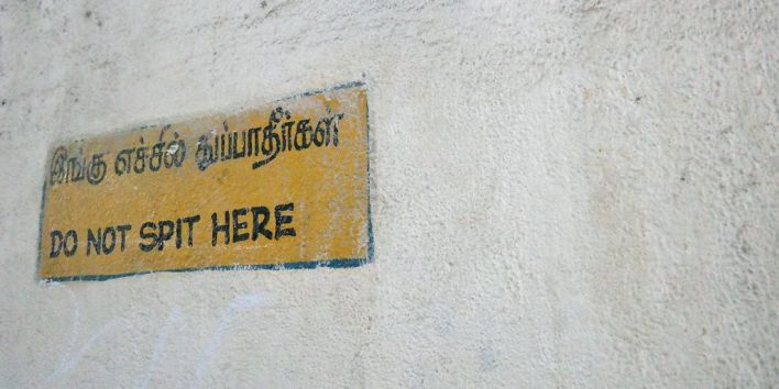 no spitting india sign spit