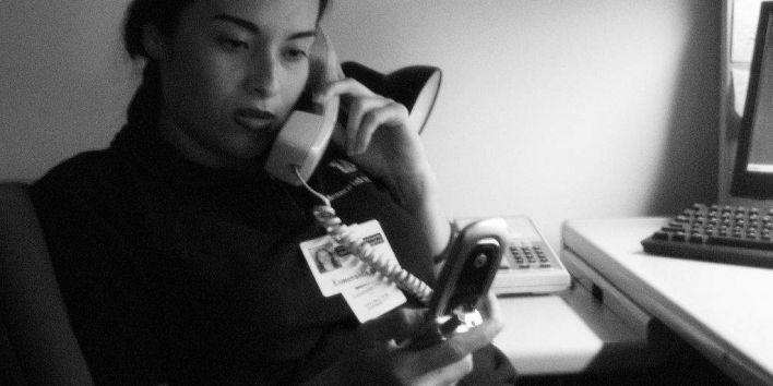 woman multi tasking phone work