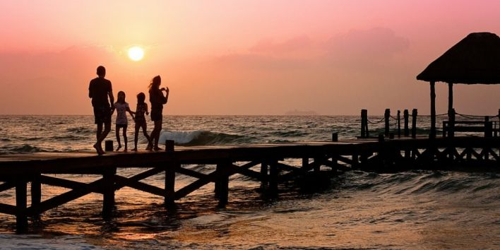 family holiday ocean vacation travel pier sunset