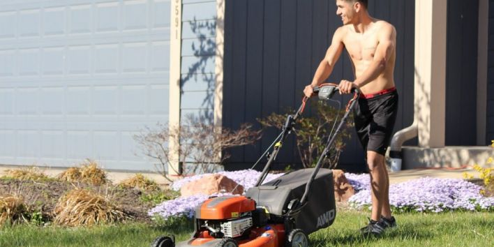 grass mowing garden work man